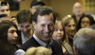 Republican presidential candidate and former Pennsylvania Sen. Rick Santorum speaks Jan. 1, 2012, to local residents during a campaign stop at the Daily Grind coffee shop in Sioux City, Iowa. (Associated Press)