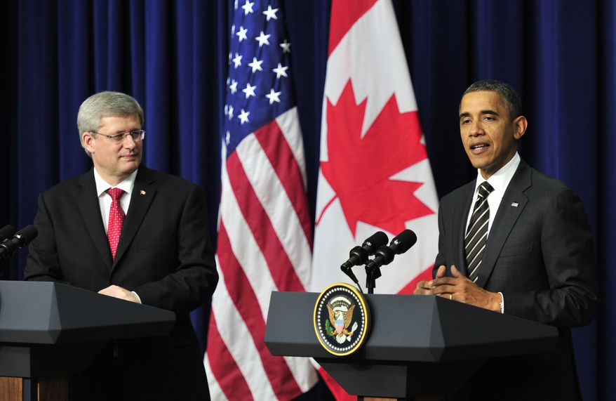**FILE** Canadian Prime Minister Stephen Harper (left) listens as President Obama speaks following a meeting at the White House in Washington on Dec. 7, 2011. President Obama warned congressional Republicans that he would reject any effort to tie extraneous issues to an extension of the payroll tax cut, including the approval of an oil pipeline between the U.S. and Canada. (Associated Press/The Canadian Press)