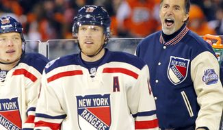 New York Rangers coach John Tortorella, right, argues a penalty call as Ruslan Fedotenko, left, and Brad Richards look on late in the third period of the NHL Winter Classic game against the Philadelphia Flyers, Monday, Jan. 2, 2012, in Philadelphia. New York won 3-2. (AP Photo/Tom Mihalek)