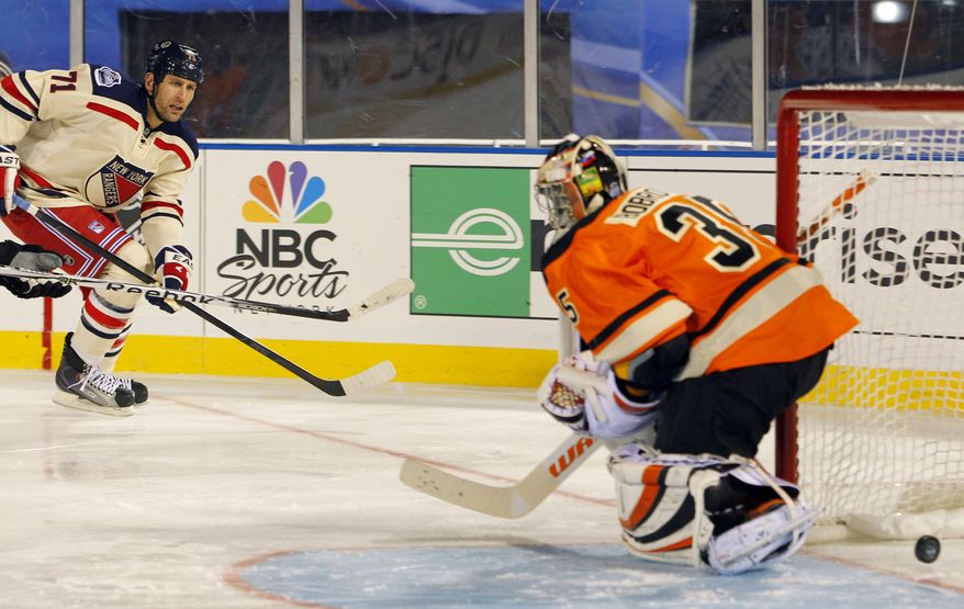New York Rangers' Mike Rupp (71) scores a goal past Philadelphia Flyers' Sergei Bobrovsky in the third period of the NHL Winter Classic game, Monday, Jan. 2, 2012, in Philadelphia. (AP Photo/Tom Mihalek)