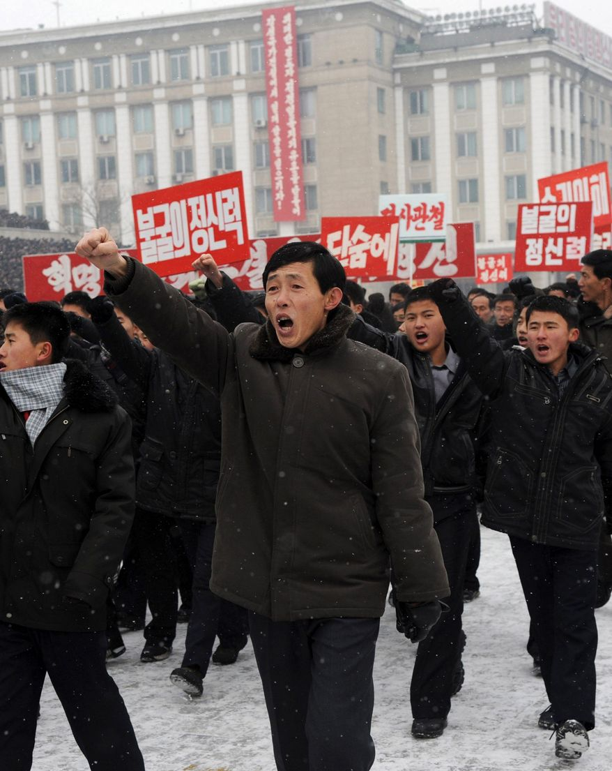 An estimated 100,000 North Koreans march Tuesday at Kim Il-Sung Square in Pyongyang in support of their country's policies and new leader, Kim Jong-un. The massive rally and footage of his meeting Monday with soldiers are part of a campaign to build support for Mr. Kim that began the day news broke of his father's death last month. (Associated Press)