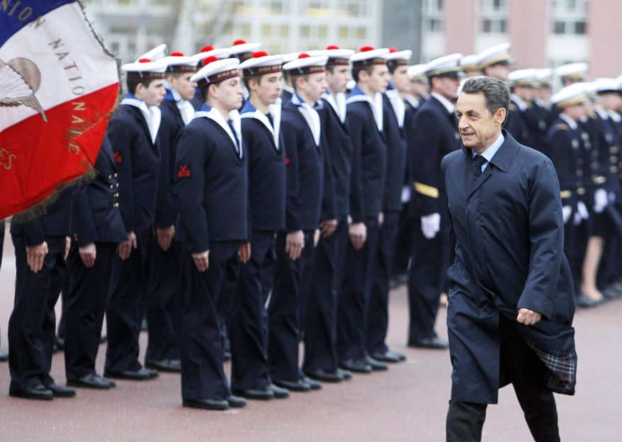 "French President Nicolas Sarkozy reviews sailors in Lanveoc-Poulmic before a speech in which he called the violence in Syria ""a massacre."" (Associated Press)"