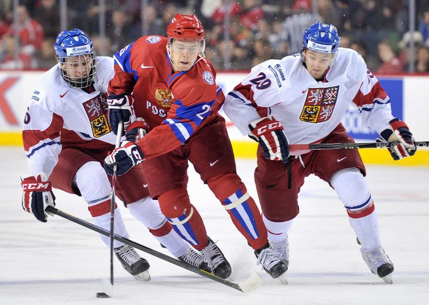 The Capitals took Russian forward Evgeny Kuznetsov (center) with the 26th overall pick in the 2010 draft. His playmaking ability has earned comparisons to countrymen Alexander Semin and Evgeni Malkin. (Associated Press)