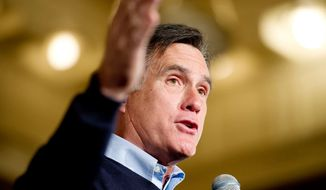 Republican presidential candidate Mitt Romney holds an early morning rally at the Temple for Performing Arts on the day of the Iowa caucus, Des Moines, IA, Tuesday, January 3, 2012. (Andrew Harnik / The Washington Times)