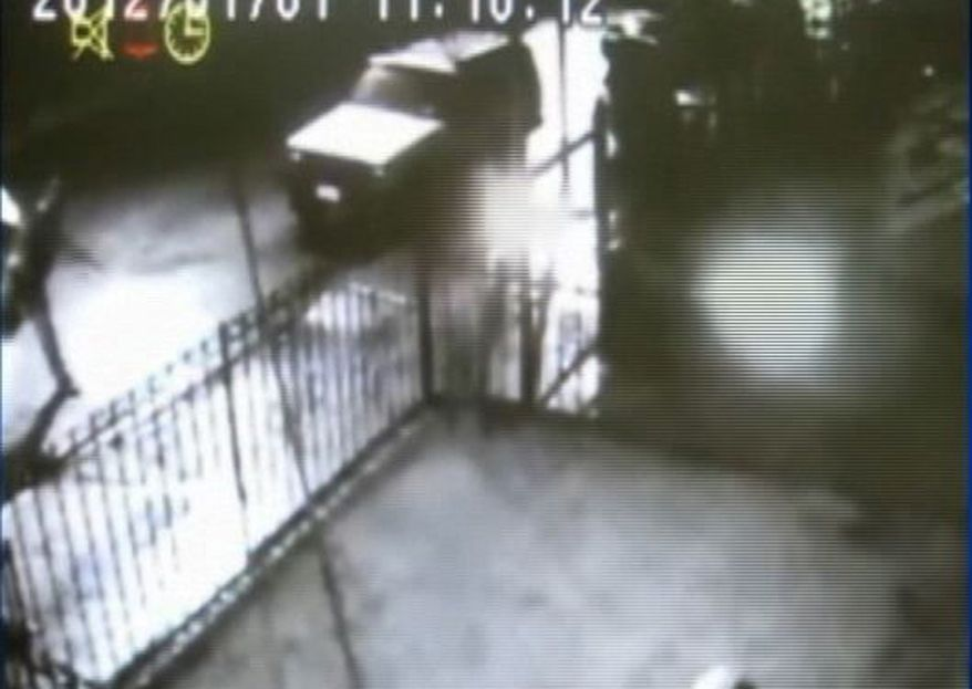In this frame grab taken from surveillance video, a suspect throws a lit object at a home in the Queens borough of New York on Jan. 1, 2012. This attack and three others in the neighborhood, including one on a globally prominent Islamic cultural center, are being investigated as possibly linked bias crimes. (Associated Press/NYPD)