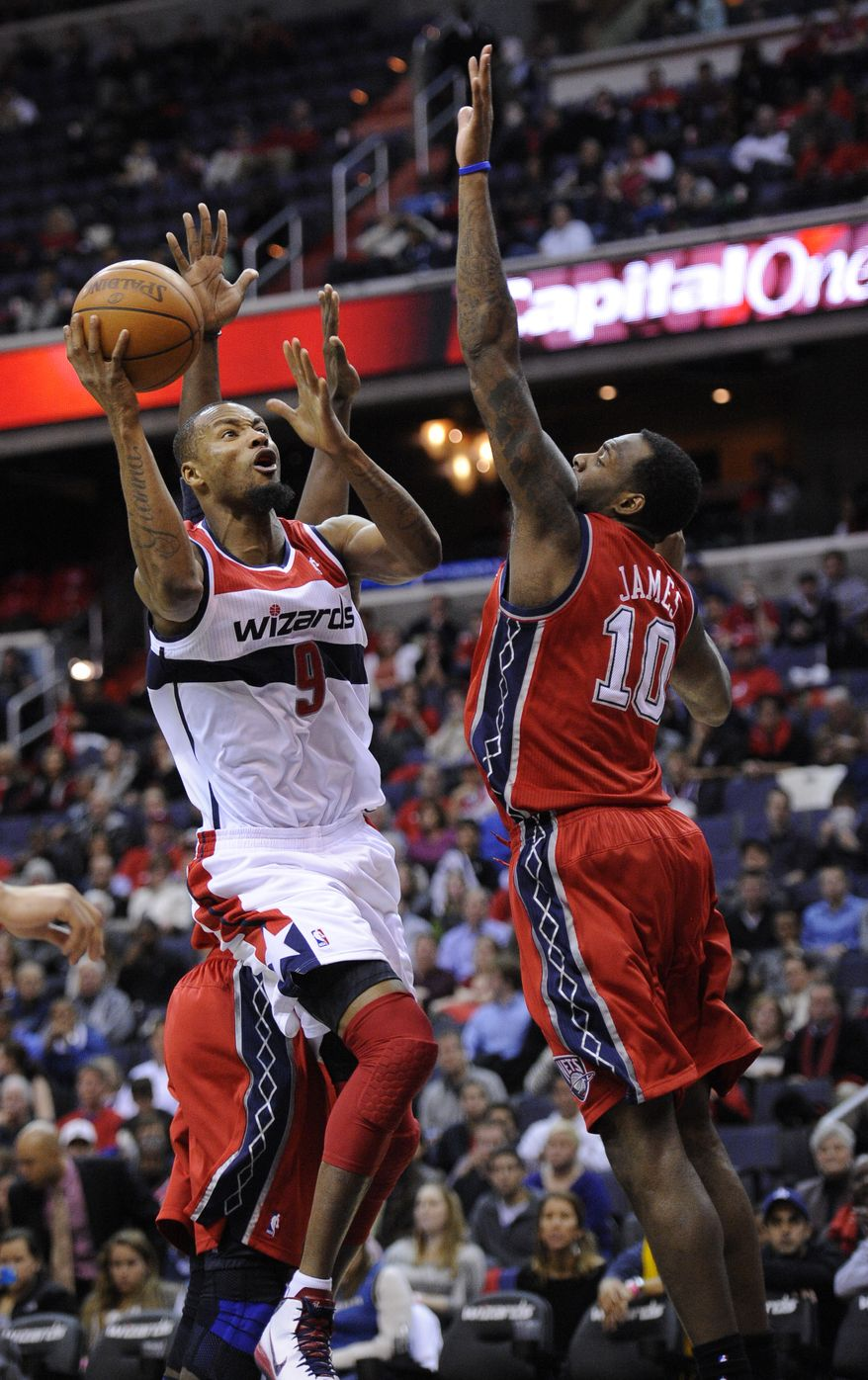 """""""It's very tough for a young team to learn when you've got nothing but young guys on a team, because they follow each other's lead,"""" said Wizards forward Rashard Lewis (9). (Associated Press)"""