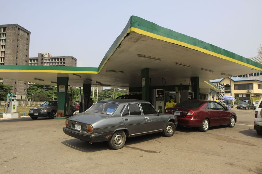 Cars wait to buy fuel at a petrol station in Lagos, Nigeria, on Jan. 2, 2012. Nigeria is ending fuel subsidies, a move that is sure to be unpopular in the oil-rich nation where citizens have come to expect cheap fuel as one of their few government benefits. (Associated Press)