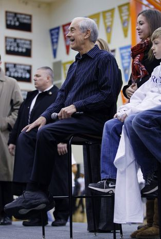 Republican presidential candidate Rep. Ron Paul of Texas is introduced at a forum at Valley High School, Tuesday, Jan. 3, 2012, in West Des Moines, Iowa. (AP Photo/Eric Gay)