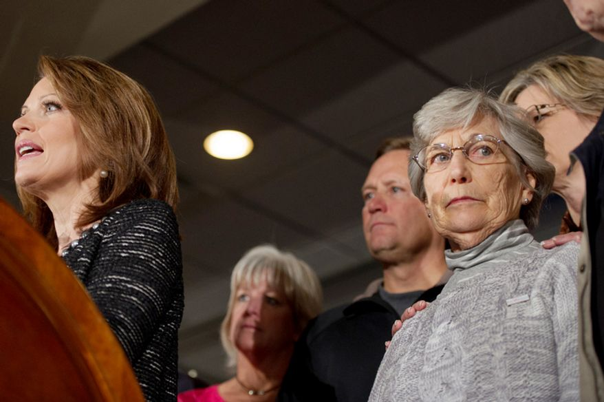 """Rep. Michele Bachmann's mother, Arlene """"Jean"""" Amble Lafave (right), stands close as her daughter (left) announces on Wednesday, Jan. 4, 2012, in West Des Moines, Iowa, that she will end her Republican presidential campaign. (Andrew Harnik/The Washington Times)"""
