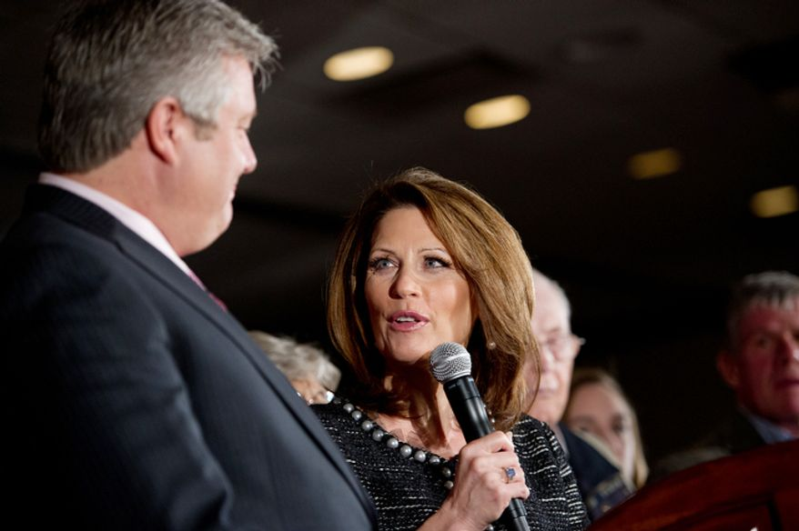 Marcus Bachmann stands next to his wife, Rep. Michele Bachmann, as she announces the end of her GOP presidential campaign in West Des Moines, Iowa, on Wednesday, Jan. 4, 2012. (Andrew Harnik/The Washington Times)