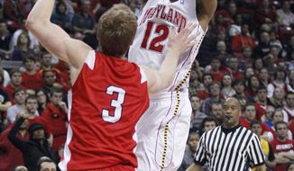 Maryland guard Terrell Stoglin (12) shoots over Cornell guard Chris Wroblewski in the second half of an NCAA basketball game in College Park, Md., Tuesday, Jan. 3, 2012. Stoglin contributed 14 points to Maryland's 70-62 win. (AP Photo/Patrick Semansky)