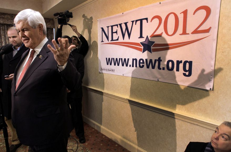 Republican presidential candidate and former House Speaker Newt Gingrich talks Jan. 4, 2012, to reporters after a campaign stop in Concord, N.H. (Associated Press)