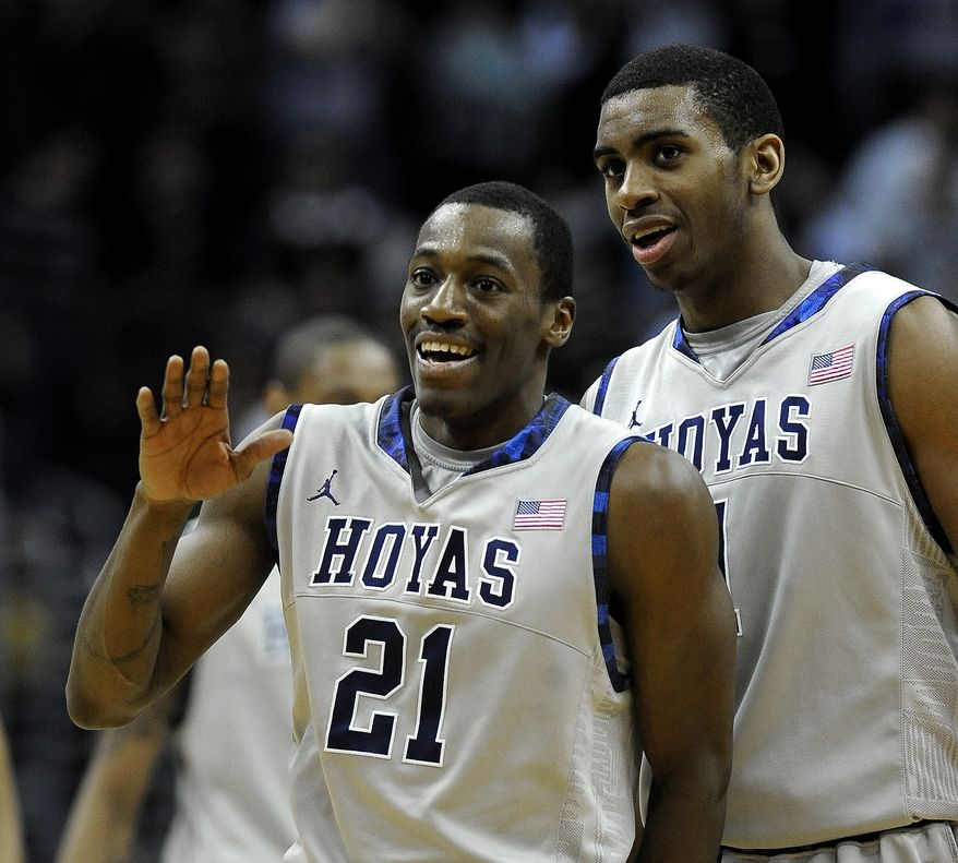 Georgetown's Jason Clark (21) and Hollis Thompson celebrate their 73-70 victory over Marquette, Wednesday, Jan. 4, 2012, in Washington. (AP Photo/Richard Lipski)