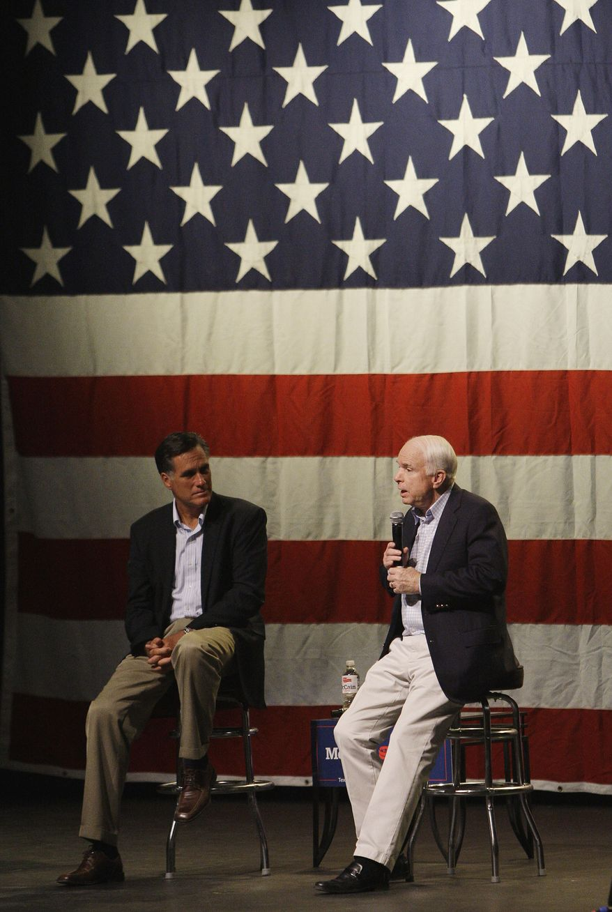 **FILE** Sen. John McCain (right), Arizona Republican, answers questions on stage  June 4, 2010, as he is joined by former Massachusetts Gov. Mitt Romney during a town hall meeting in Mesa, Ariz. (Associated Press)