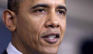 **FILE** President Obama speaks Dec. 20, 2011, in the White House. (Associated Press)