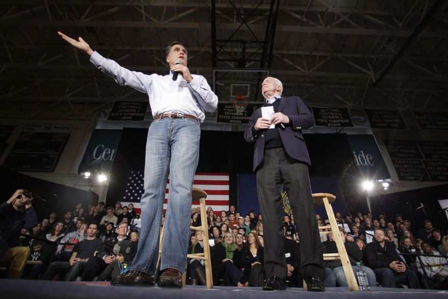 Republican presidential candidate and former Massachusetts Gov. Mitt Romney (left), accompanied by Sen. John McCain, Arizona Republican, campaigns Jan. 4, 2012, during a town hall style meeting in Manchester, N.H. (Associated Press)