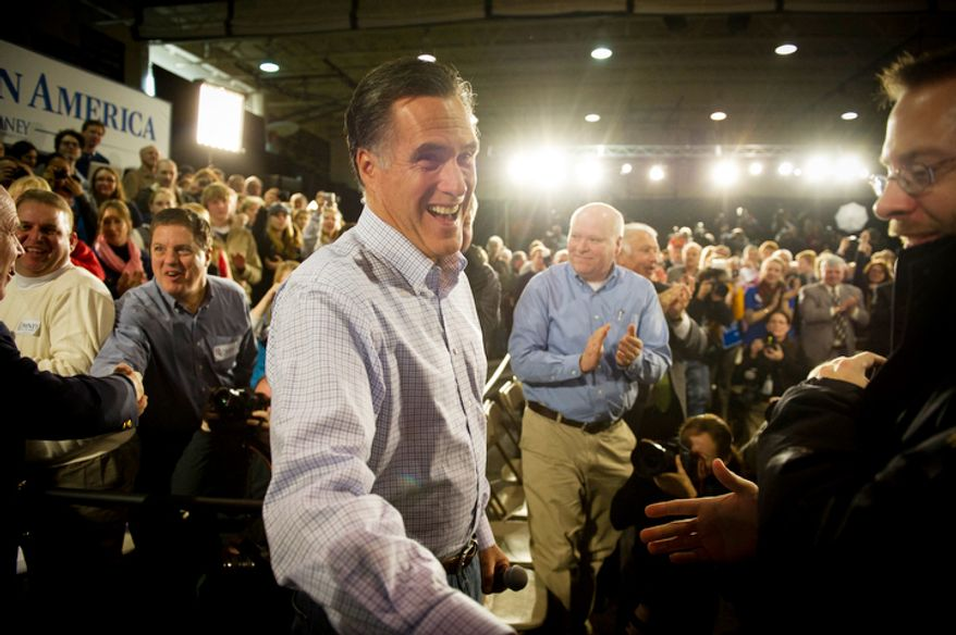 Former Massachusetts Gov. Mitt Romney greet supporters at a town-hall meeting in Manchester, N.H., on Wednesday, Jan. 4, 2012. (Rod Lamkey Jr./The Washington Times)