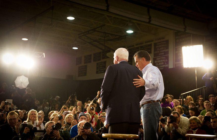 Sen. John McCain (left) joins former Massachusetts Gov. Mitt Romney at a town-hall meeting in Manchester, N.H., on Wednesday, Jan. 4, 2012. Mr. McCain, Mr. Romney's rival in 2008 for the GOP presidential nod, endorsed Mr. Romney in this year's White House race. (Rod Lamkey Jr./The Washington Times)
