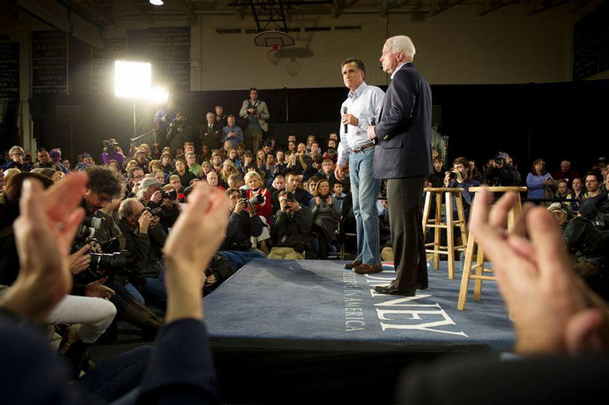 Former Massachusetts Gov. Mitt Romney (left) gets the endorsement of Sen. John McCain in his White House bid during a town-hall meeting in Manchester, N.H., on Wednesday, Jan. 4, 2012. (Rod Lamkey Jr./The Washington Times)