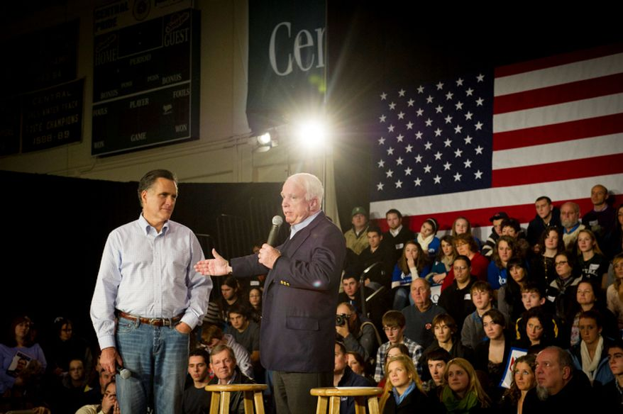 Former Massachusetts Gov. Mitt Romney is joined onstage by Sen. John McCain in Manchester, N.H., on Wednesday, Jan. 4, 2012, as the Arizona senator endorses Mr. Romney's Republican presidential candidacy. (Rod Lamkey Jr./The Washington Times)