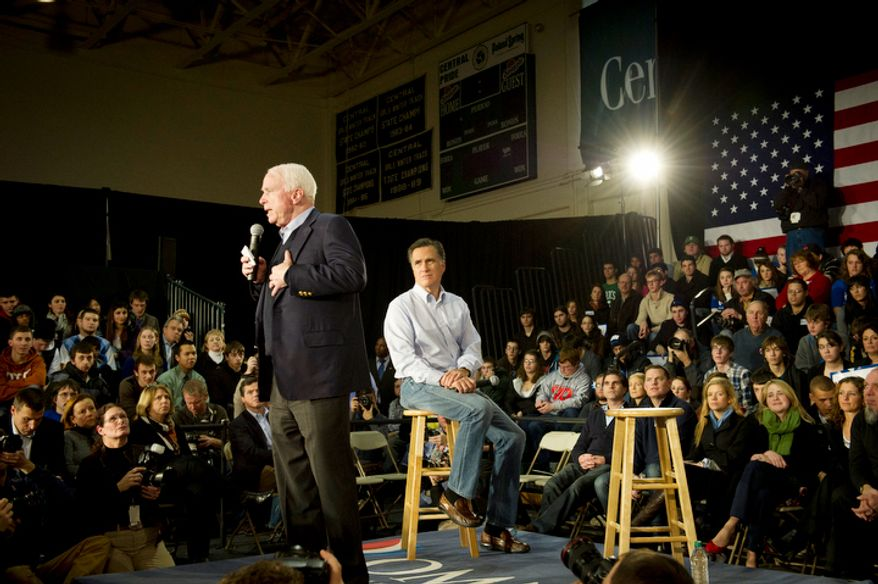 With less than a week before the nation's first presidential primary, Sen. John McCain (left) endorses former Massachusetts Gov. Mitt Romney (right) for the GOP presidential nomination during a town-hall meeting in Manchester, N.H., on Wednesday, Jan. 4, 2012. (Rod Lamkey Jr./The Washington Times)