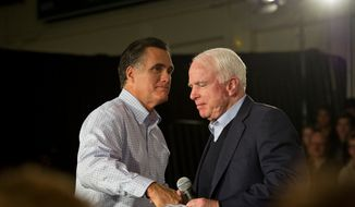 ** FILE ** Former Massachusetts Gov. Mitt Romney (left) and Sen. John McCain shake hands during a Romney presidential campaign stop in Manchester, N.H., on Wednesday, Jan. 4, 2012. (Rod Lamkey Jr./The Washington Times)