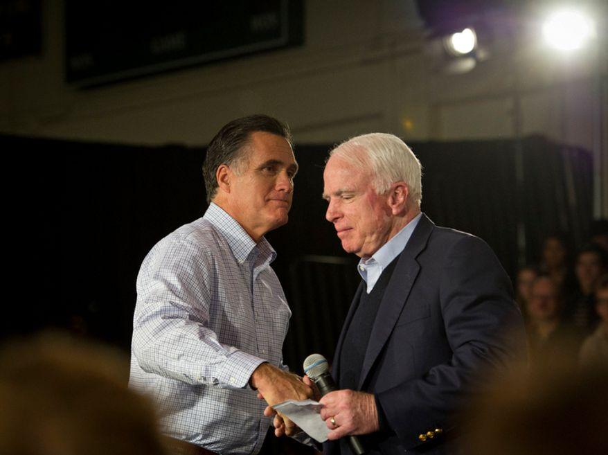 ** FILE ** Former Massachusetts Gov. Mitt Romney (left) and Sen. John McCain shake hands during a Romney presidential campaign stop in Manchester, N.H., on Wednesday, Jan. 4, 2012. (Rod Lamkey Jr./The Washington Times)