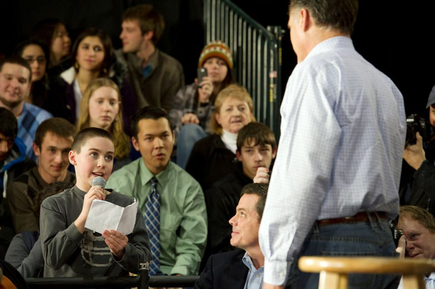 Former Massachusetts Gov. Mitt Romney fields a question from a youth in the crowd at a town-hall-style campaign stop at Manchester Central High School in Manchester, N.H., on Wednesday, Jan. 4, 2012. (Rod Lamkey Jr./The Washington Times)