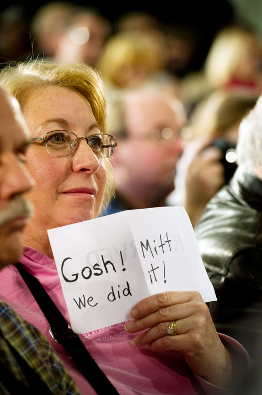 Susan Mielbrecht of Moultonborough, N.H., holds a handmade sign at a town-hall meeting at Manchester Central High School in Manchester, N.H., on Wednesday, Jan. 4, 2012, as Sen. John McCain endorses former Massachusetts Gov. Mitt Romney for the Republican presidential nomination. (Rod Lamkey Jr./The Washington Times)