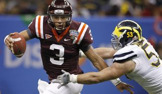 Virginia Tech quarterback Logan Thomas (3) is sacked by Michigan defensive end Ryan Van Bergen during the fourth quarter of Michigan's 23-20 overtime victory in the Sugar Bowl in New Orleans on Jan. 3, 2012. (Associated Press)