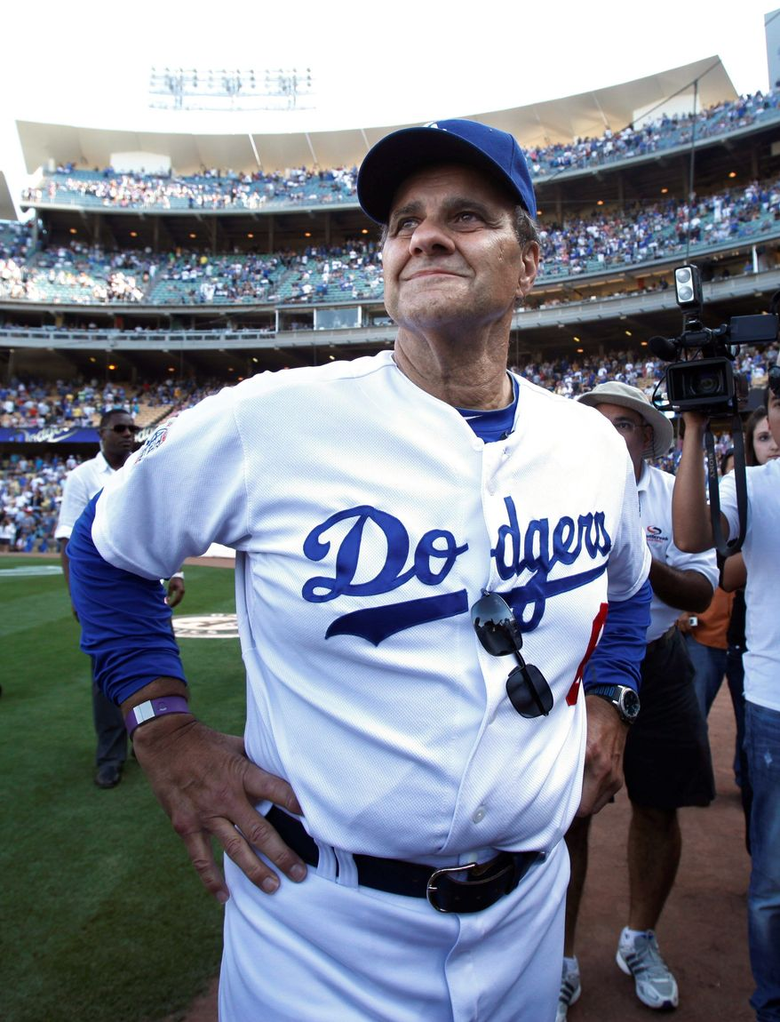 Joe Torre is part of a consortium that wants to buy the bankrupt Dodgers from Frank and Jamie McCourt. (Associated Press)