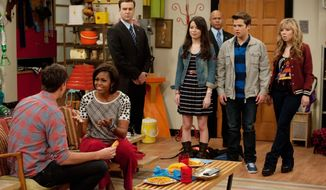 "First lady Michelle Obama talks with Jerry Trainor in an episode of Nickelodeon's ""iCarly."" The episode, premiering Jan. 16, centers on Carly's reaction when her military dad is redeployed. (Nickelodeon via Associated Press)"