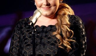 """Adele's hugely popular sophomore album """"21"""" sold 5.8 million copies last year, according to Nielsen SoundScan. Huge interest in Adele also led to the sales of 856,000 copies of """"19,"""" her debut album from 2008. (Associated Press)"""