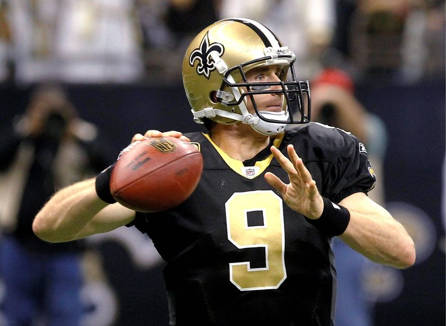 New Orleans quarterback Drew Brees led the NFL with 46 TDs and a record 5,476 yards passing. (Associated Press)