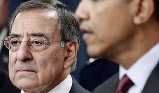 Defense Secretary Leon E. Panetta stands by President Obama as he explains changes to military force and strategy that will result in the biggest defense cuts since the end of the Cold War. (Associated Press)