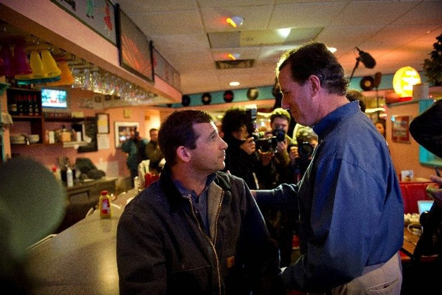 Mike Ahern (left) of Plymouth, N.H., asks GOP presidential candidate Rick Santorum about the lack of jobs not related to stores that pay minimum wage that make it hard for people to succeed financially during a lunchtime visit to the Tilt'n Diner. (Rod Lamkey Jr./The Washington Times)