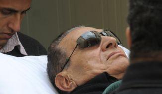 Former Egyptian President Hosni Mubarak arrives in court by gurney in Cairo on Thursday, Jan. 5, 2012. (AP Photo/Mohammed al-Law)