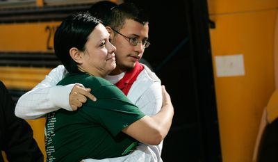 Jennifer Davila (left) embraces her son, Jordan, on Jan. 4, 2012, as he is escorted into a park near Cummings Middle School in Brownsville, Texas, after a fatal shooting at the school that morning. Officers summoned to the school shot and killed an eighth-grader after he ignored their order to drop a handgun he was brandishing and instead pointed it at them, police said. (Associated Press/The Brownsville Herald)