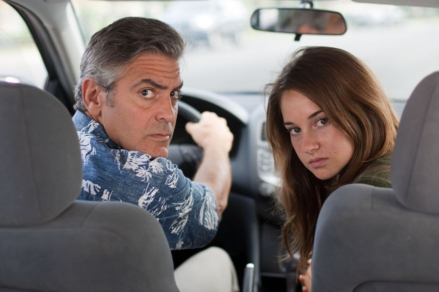 """George Clooney (left) and Shailene Woodley are shown in a scene from """"The Descendants."""" (AP Photo/Fox Searchlight Films, Merie Wallace)"""