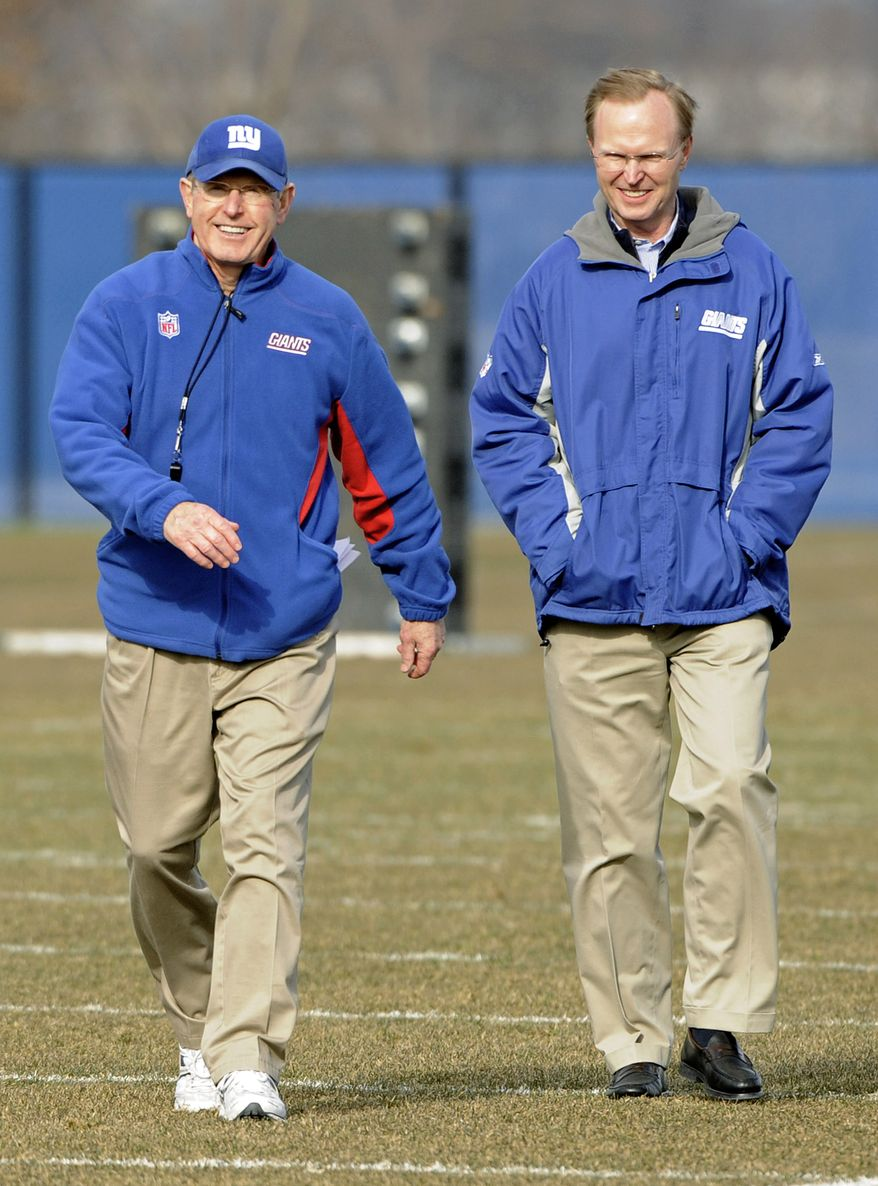 New York Giants coach Tom Coughlin smiles as he walks off the field with owner John Mara after practice Friday, Jan. 6, 2012, in East Rutherford, N.J. The Giants are slated to host the Atlanta Falcons on Sunday in a wild-card playoff game. (AP Photo/Bill Kostroun)