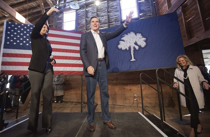 Republican presidential candidate and former Massachusetts Gov. Mitt Romney (center) is joined Jan. 6, 2012, at a campaign event in Conway, S.C., by South Carolina Gov. Nikki Haley (left) and wife Ann. (Associated Press)