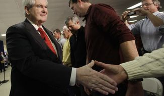 Republican presidential candidate, former House Speaker Newt Gingrich shakes hands at campaign town meeting in Salem, N.H., Friday, Jan. 6, 2012. (AP Photo/Elise Amendola)