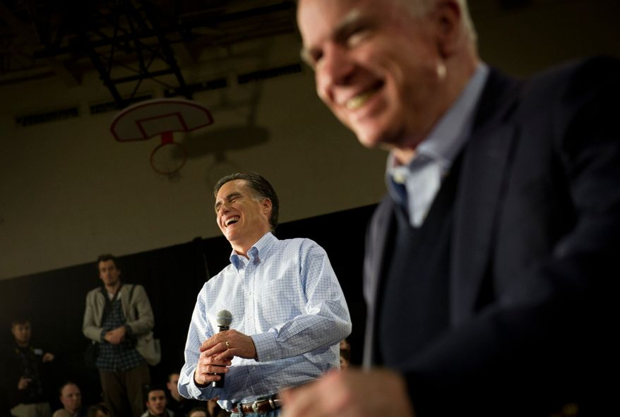 With less than a week before the nation's first presidential primary, Republican presidential candidate and former Massachusetts governor Mitt Romney is joined on stage with Sen. John McCain R-AZ as he gets the endorsement of Sen. McCain at a townhall meeting at Manchester Central High School in Manchester,NH, Wednesday, January 4, 2012. (Rod Lamkey Jr/ The Washington Times)