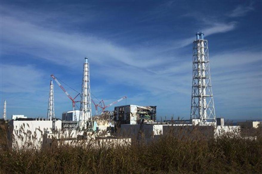 ** FILE ** This Nov. 12, 2011, photo shows the crippled Fukushima Dai-ichi nuclear power plant in Okuma town, Japan. (AP Photo/David Guttenfelder, Pool, File)