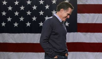 Republican presidential candidate, former Massachusetts Gov. Mitt Romney, listens as he is introduced by Sen. Kelly Ayotte, R-N.H., as he campaigns at Pinkerton Academy in Derry, N.H., Saturday, Jan. 7, 2012. (AP Photo/Charles Dharapak)