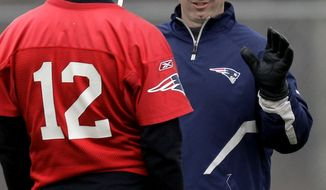 ** FILE ** In this Dec. 14, 2011, file photo, New England Patriots offensive coordinator/quarterbacks coach Bill O'Brien talks with quarterback Tom Brady (12) during NFL football practice in Foxborough, Mass. O'Brien's agent said he was interviewing Thursday, Jan. 5, 2012, for the vacant Penn State head-coaching position. (AP Photo/Stephan Savoia, File)