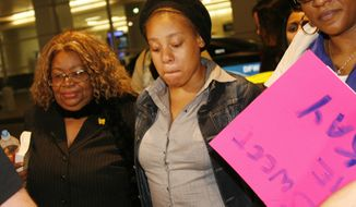 Jakadrien Turner, age 15, center, walks with her grandmother Lorene Turner, left, and mother Johnisa Turner, right, all of Dallas, at DFW Airport in Fort Worth, Texas, on Friday Jan. 6, 2012. Jakadrien Turner was mistakenly deported to Colombia after Immigration and Customs Enforcement say she claimed to be Colombian woman named Tika Lanay Cortez. (AP Photo/Mike Fuentes)