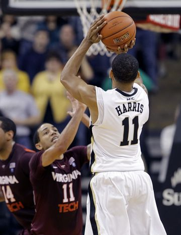 Wake Forest's C.J. Harris, right, shoots the game-winning shot over Virginia Tech's Erick Green, left, in the final seconds of Wake Forest's 58-55 win in Winston-Salem, N.C., Saturday, Jan. 7, 2012. (AP Photo/Chuck Burton)