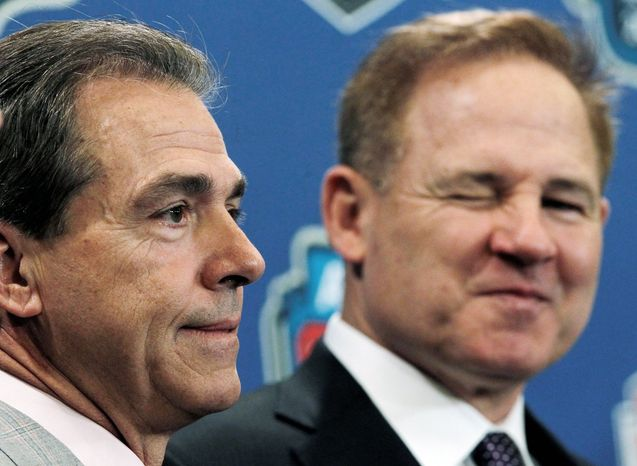 Alabama coach Nick Saban (left) and LSU counterpart Les Miles met Nov. 5, a 9-6 overtime win by LSU in which neither team scored a touchdown. (Associated Press)