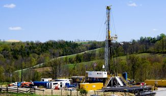 """**FILE** A Chesapeake Energy natural gas well site operates near Burlington, Pa. Natural gas locked in dense rock deep beneath Pennsylvania, New York, West Virginia and Ohio requires a powerful drilling process called hydraulic fracturing, or """"fracking,"""" to release it. (Associated Press)"""